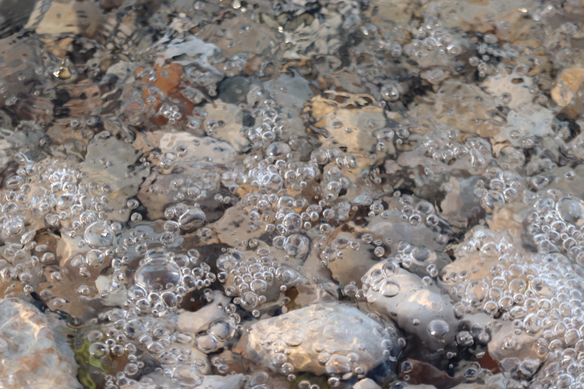Water Bubbles On The Rocks