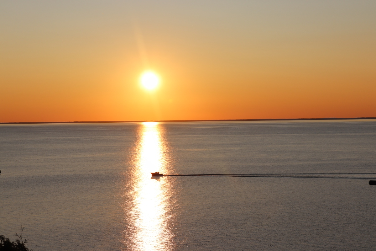Boat In Sunset On Lake Michigan